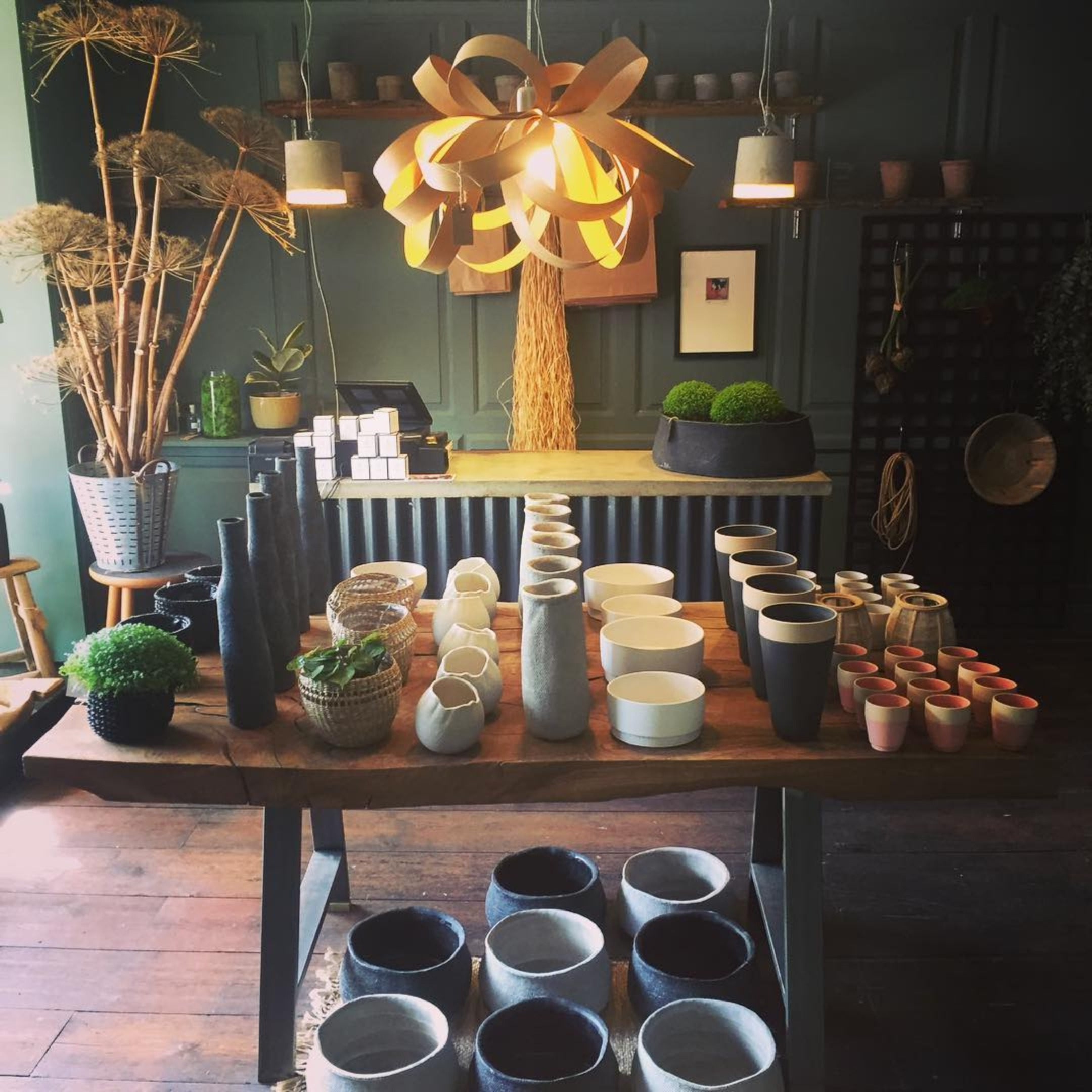 KAGU interiors shop with pots, vases and bespoke table