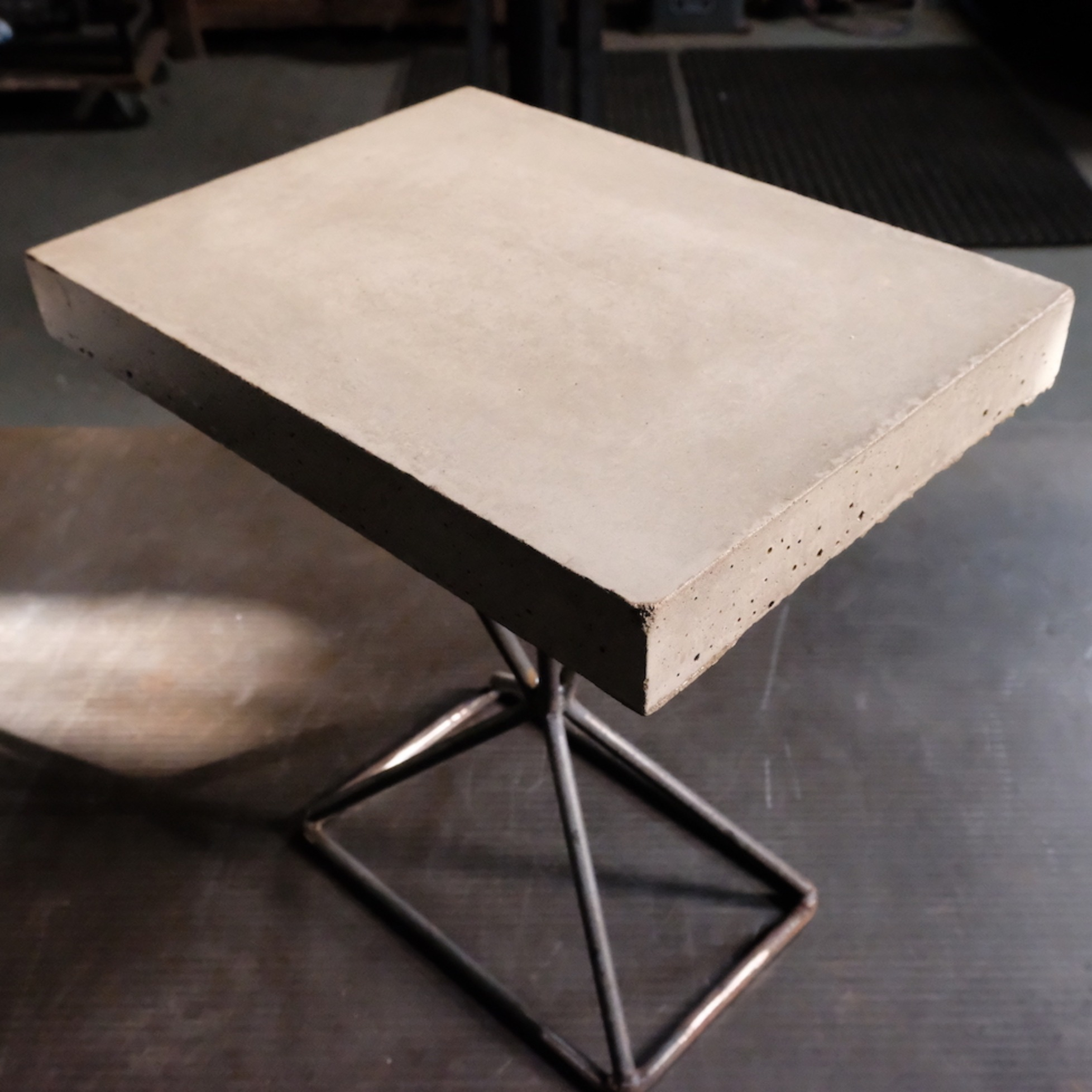 Smooth concrete bespoke side table by KAGU